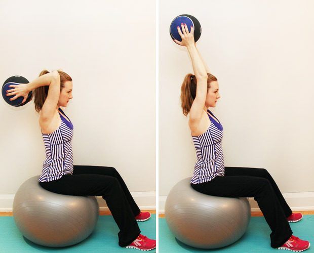 Sitting on stability ball and holding medicine ball behind head ...
