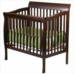 Delta Children's Products Riley 4-in-1 Convertible Wood Mini Crib in Dark Cherry