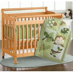 JCPenney Mini Emily Sleigh-Style Crib by DaVinci - Cherry, Ebony, Natural, White